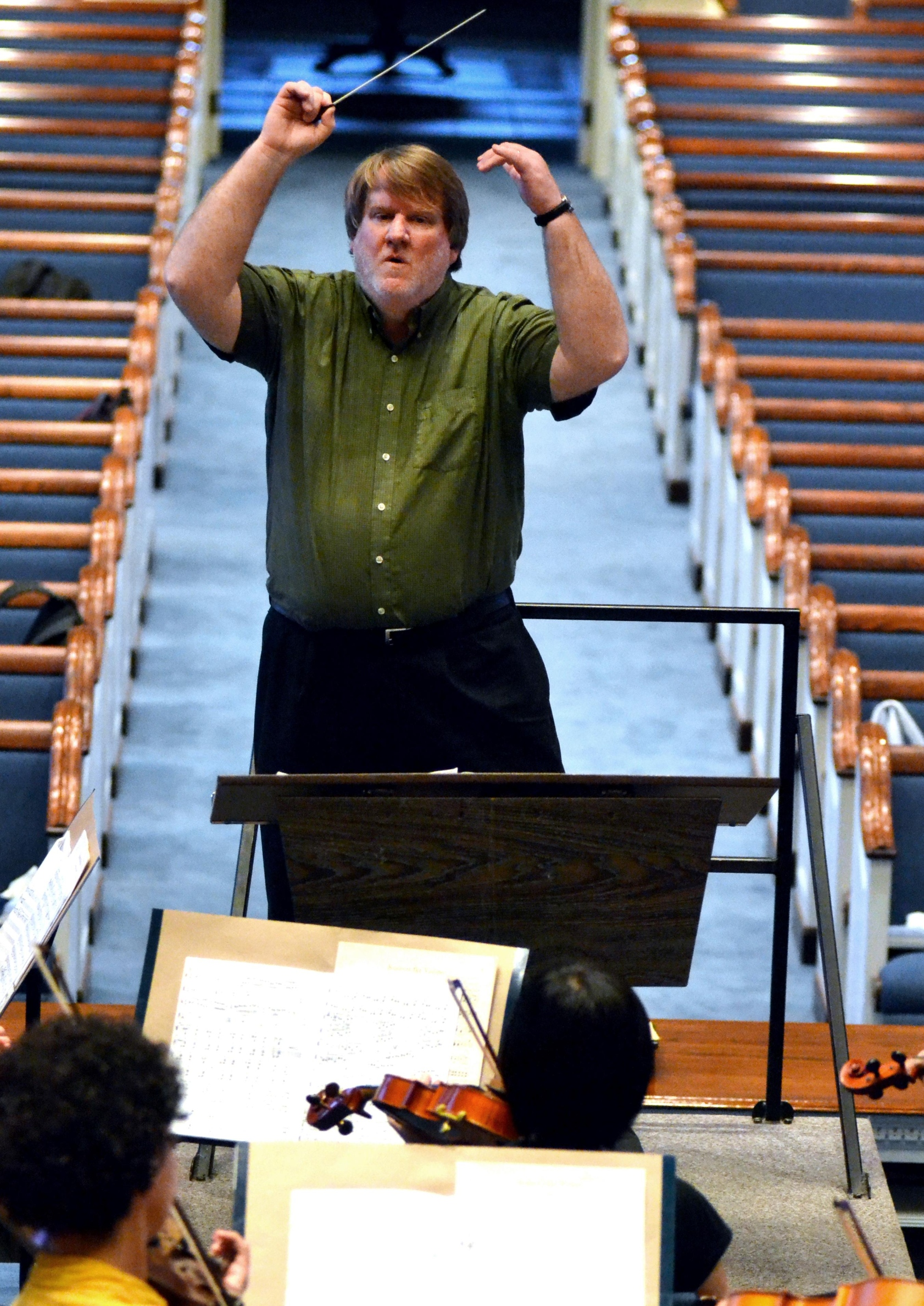 Head of Choral Activities Dr. Gregory Fuller leads USM choirs and Symphony Orchestra in a practice held at Main Street Baptist Church on Monday night. Christopher Little/Printz