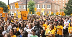 New students gather together before the painting of the Eagle Walk on Sunday during Golden Eagle Welcome Week.  Sam Bass