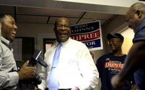 Mayor Johnny DuPree talks with supporters after speaking to the press at his campaign headquarters Tuesday. April Garon/Printz