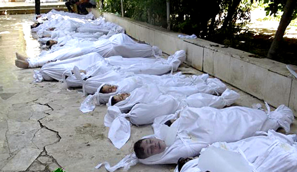 A dead Syrian child is placed on the floor at a makeshift ... |Dead Syrians