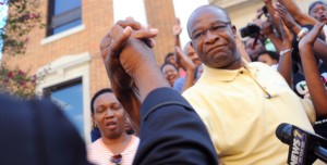 Mayor Johnny DuPree shakes hands with Rev. Kenneth Fairley in front of City Hall in downtown Hattiesburg after the release of the mayoral special election results Saturday afternoon. Christopher Little/Printz