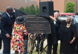 Raylawni G. A. Branch and Gwendolyn Armstrong Chamberlain uncover the bronze plaque displaying the dedication of the Armstrong-Branch Plaza. The plaza was dedicated in honor of the first two African-American students to attend The University of Southern Mississippi.   Mary Alice Truitt/Printz