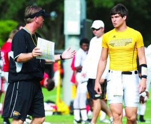 Todd Monken works with freshman quarterback Nick Mullens during a preseason practice.  Mullens was announced as the starting quarterback for the Homecoming game Saturday against North Texas. Christopher Little/Printz