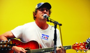 Mark Bryan of Hootie and the Blowfish performs an original song at the Songwriter's Social at T-Bones Records Wednesday night. Christopher Little/Printz
