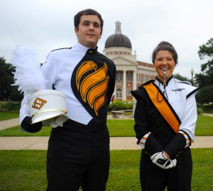 Trombone player Trent Patterson and drum major Victoria Russo showcase the new Pride uniforms.  Christopher Little/Printz