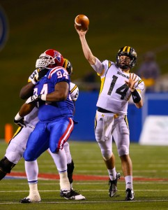 Freshman quarterback Nick Mullens makes a throw while offensive linesman Fredrick Moore blocks Louisiana Tech Bulldogs' defensive tackle Shakeil Lucas during the second half at Joe Aillet Stadium. Chuck Cook/Printz