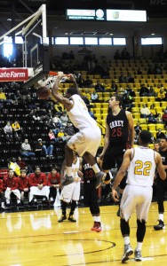 Senior forward Daveon Boardingham slam dunks for two points during Sunday's game against the William Carey Crusaders in Reed Green Coliseum. Becky Vu/Printz