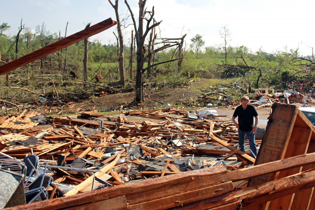 Joe Holloway surveys damage from the American Legion in Tupelo Tuesday morning, April 29. A dangerous storm system that spawned a chain of deadly tornadoes over three days flattened homes and businesses, forced frightened residents in more than half a dozen states to take cover and left tens of thousands in the dark Tuesday morning. Zachary Odom/Printz