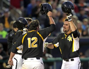 Southern Miss catcher Austin Roussel (18), right, celebrates a home run with teammates during play against LSU in the Wally Pontiff Jr. Baseball Classic at Zephyr Field in Metairie Wednesday, April 15.  Brett Duke/NOLA.com-The Times Picayune