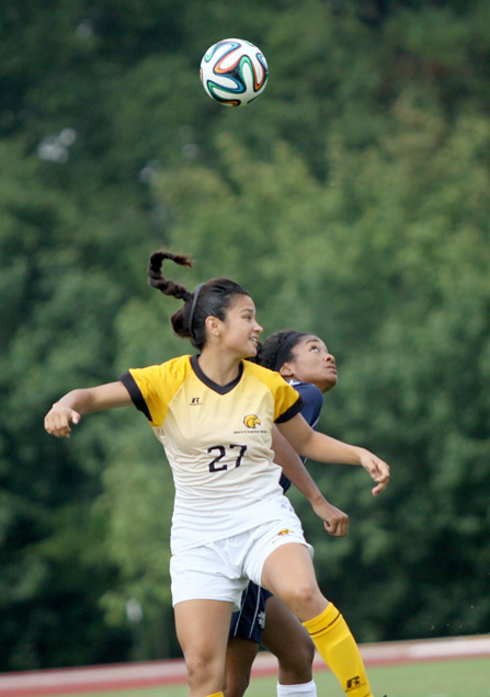 Sophomore Adriana Garcia goes for a head bump during a Southern Miss home game against Jackson State on August 29th, 2014 in Hattiesburg, MS. | Photo by Susan Broadbridge
