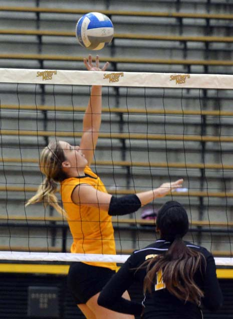 USM senior Kristen Fleming tips the ball over the net during the eagle's scrimmage match in the Reed Green Coliseum in August. - Michael Kavitz