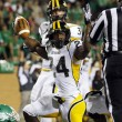Southern Miss Golden Eagles running back George Payne signals touchdown as he goes in for the score from five yards out against the North Texas Mean Green during the third quarter at Apogee Stadium. Southern Miss handed North Texas a  30-20 loss.   Ray Carlin/USA TODAY Sports