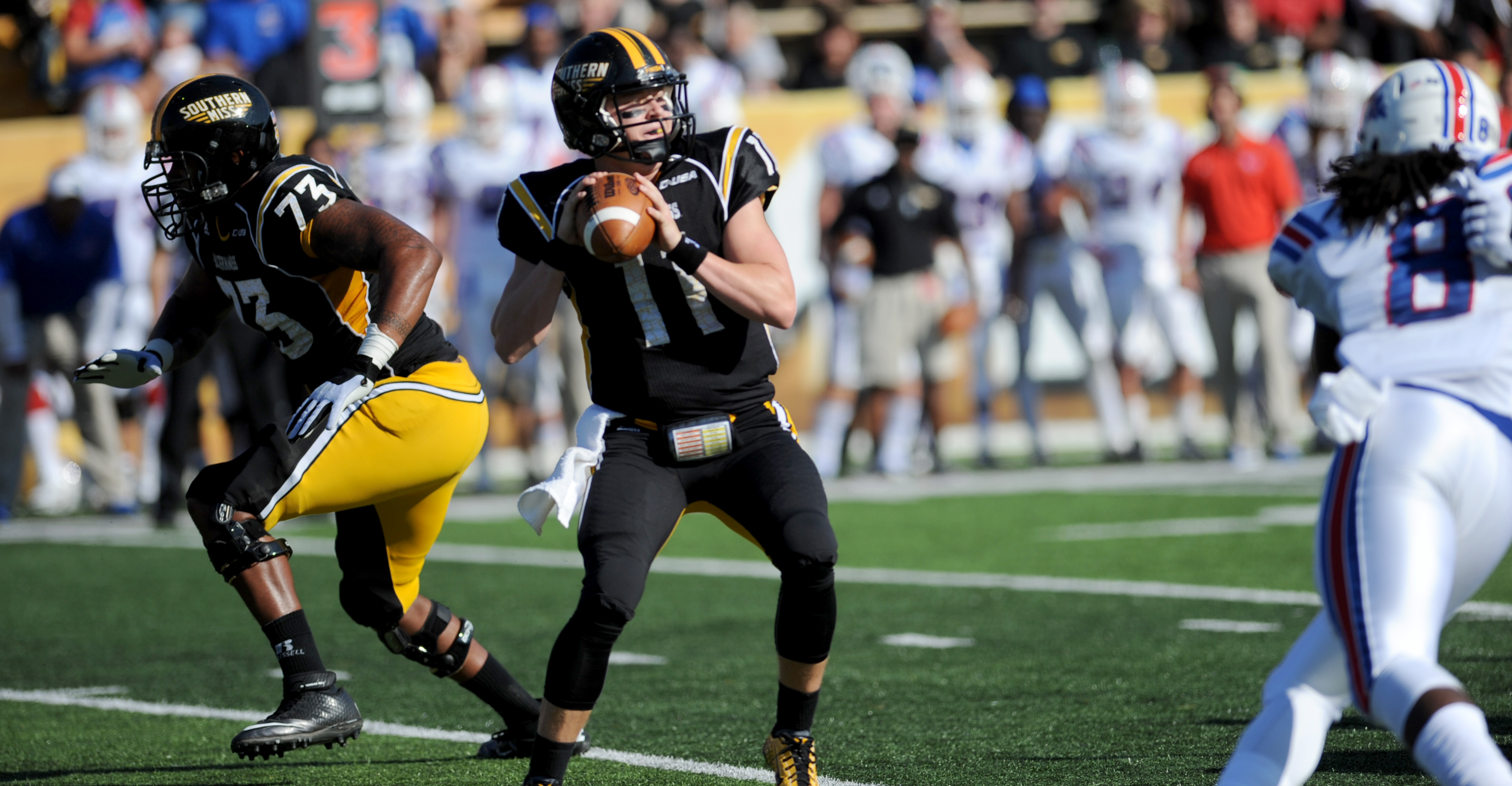 Southern Miss quarterback Cole Weeks goes for a pass against La. Tech in Hattiesburg, MS. Saturday, Oct. 25, 2014.  This past weekend the Golden Eagles fell to UTEP, 35-14.- Susan Broadbridge/Printz