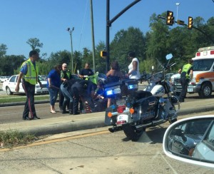 Police and emergency medical services swarm to aid the female student struck by a vehicle at about 9:35 a.m. on Friday, Aug. 28.