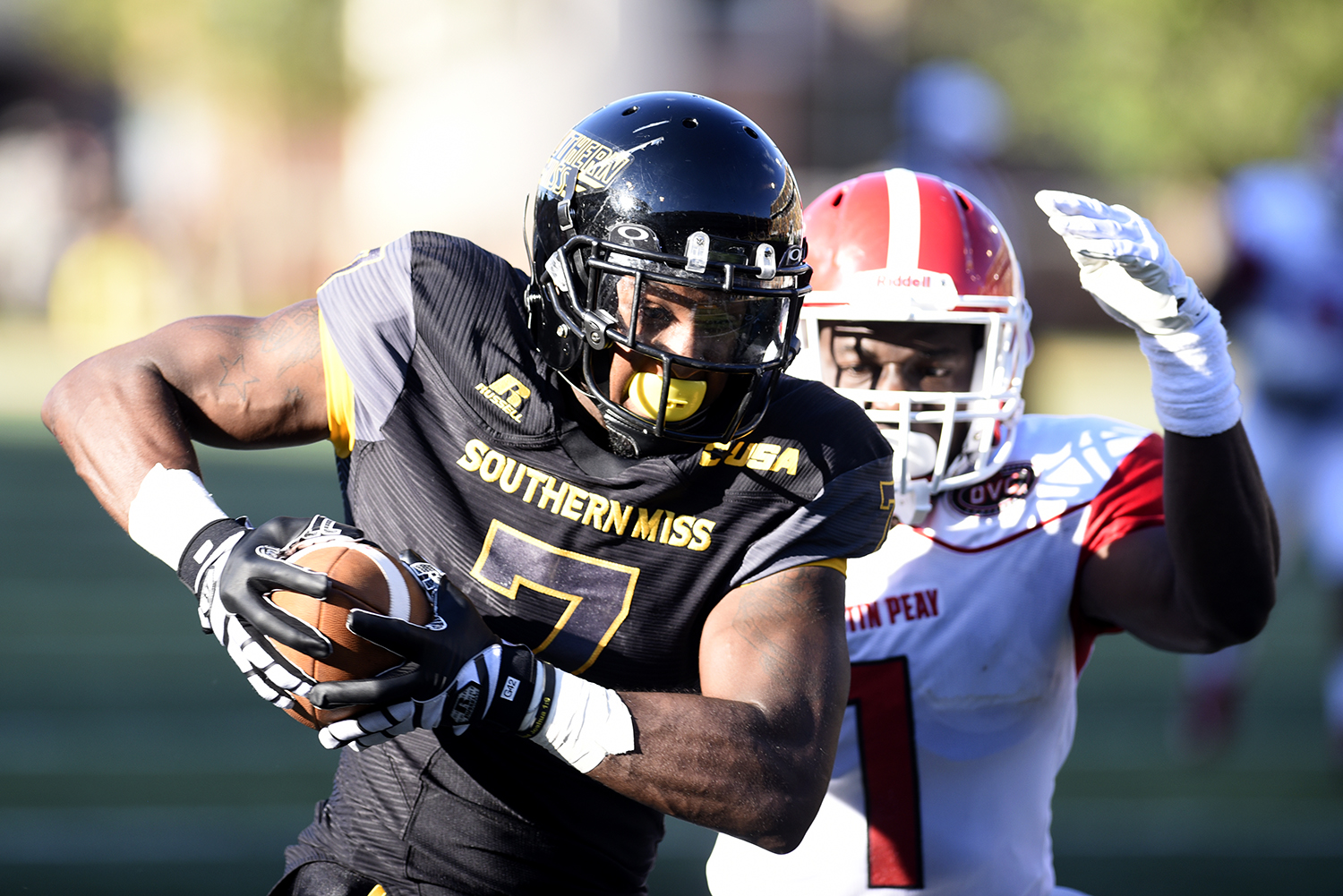 Justice Hayes runs past an Austin Peay defender during the second game of the season. The Golden Eagles won against the Governors 52-6 Sept 12, 2015.