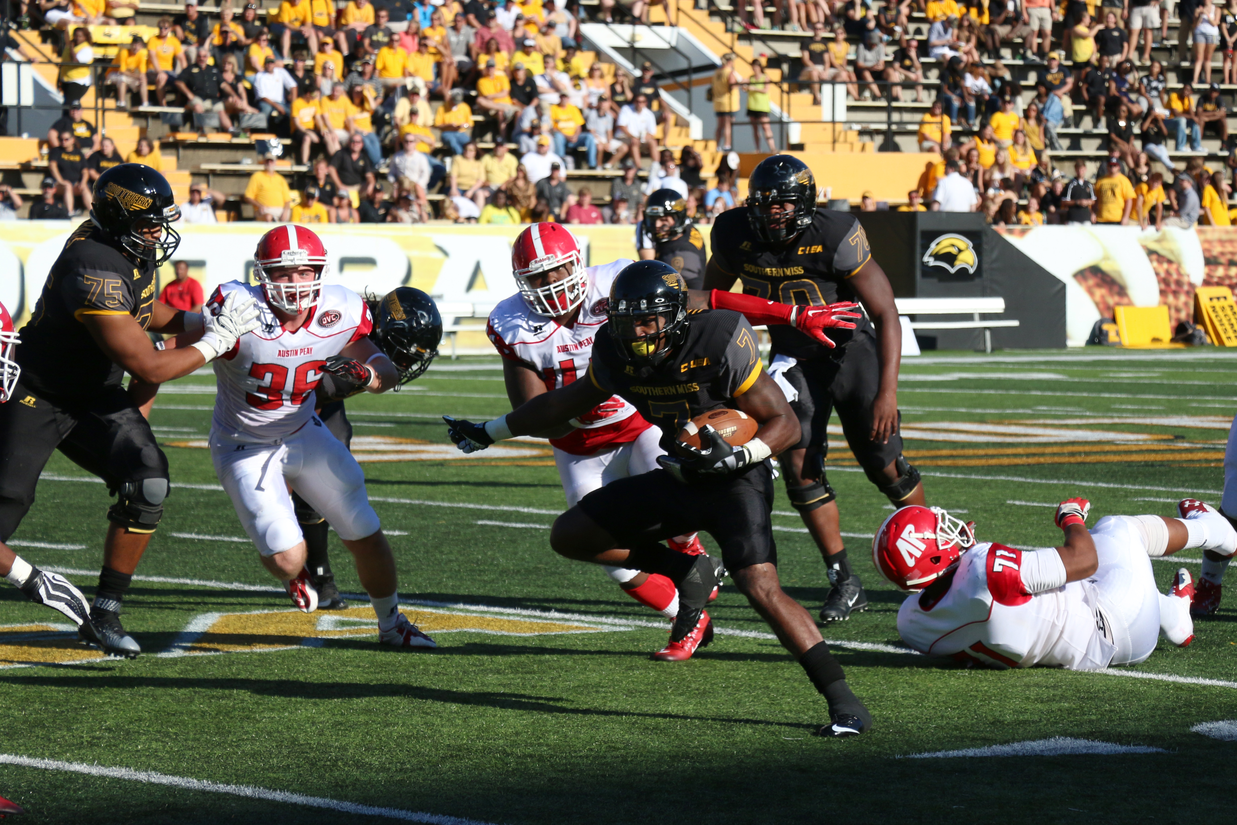 Justice Hays runs past Austin Peay defenders during the second game of the season. The Golden Eagles won 52-6 against the Governors Sept 12, 2015.