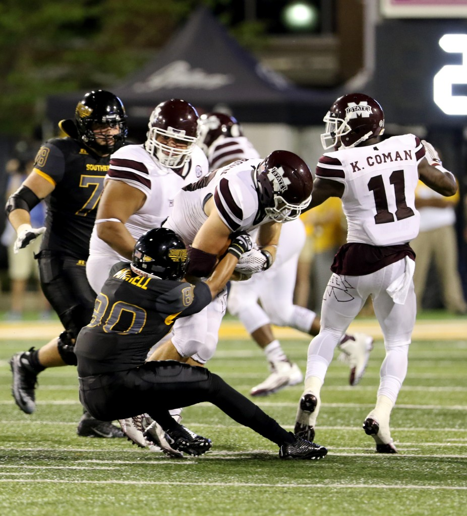 Southern Miss wide receiver Jordan Mitchell taking down a Mississippi State player in Hattiesburg on Saturday night.