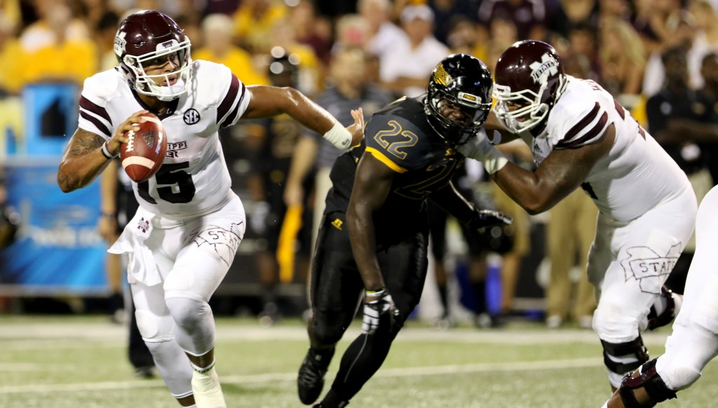 Mississippi State quarter back Dak Prescott avoiding Southern Miss line backer Darian Yancey in Hattiesburg on Saturday night.