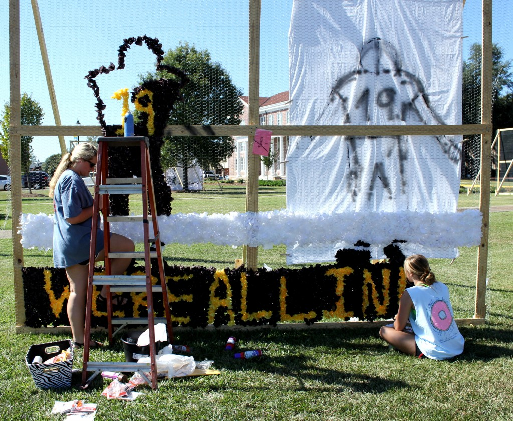 Anna Beth Weldon, left, and Myranda Gallagher, right, work on their homecoming float at the entrance of the University of Southern Mississippi on Wednesday, Oct. 14, 2015. (Photo/ Brittany Stewart)