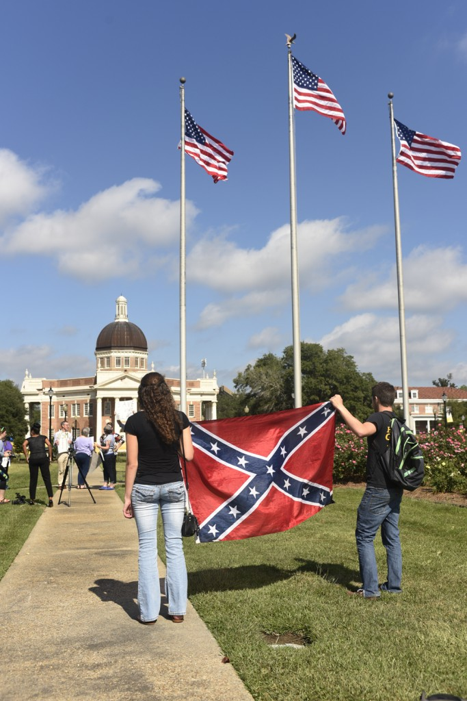 Supporters  of the Mississippi flag hold a Confederate flag after the University of Southern Mississippi removes the Mississippi State flag from its campus on Oct 28, 2015. The University of Southern Mississippi becomes the second University in Mississippi to remove the flag from the campus. Courtland Wells/Student Printz