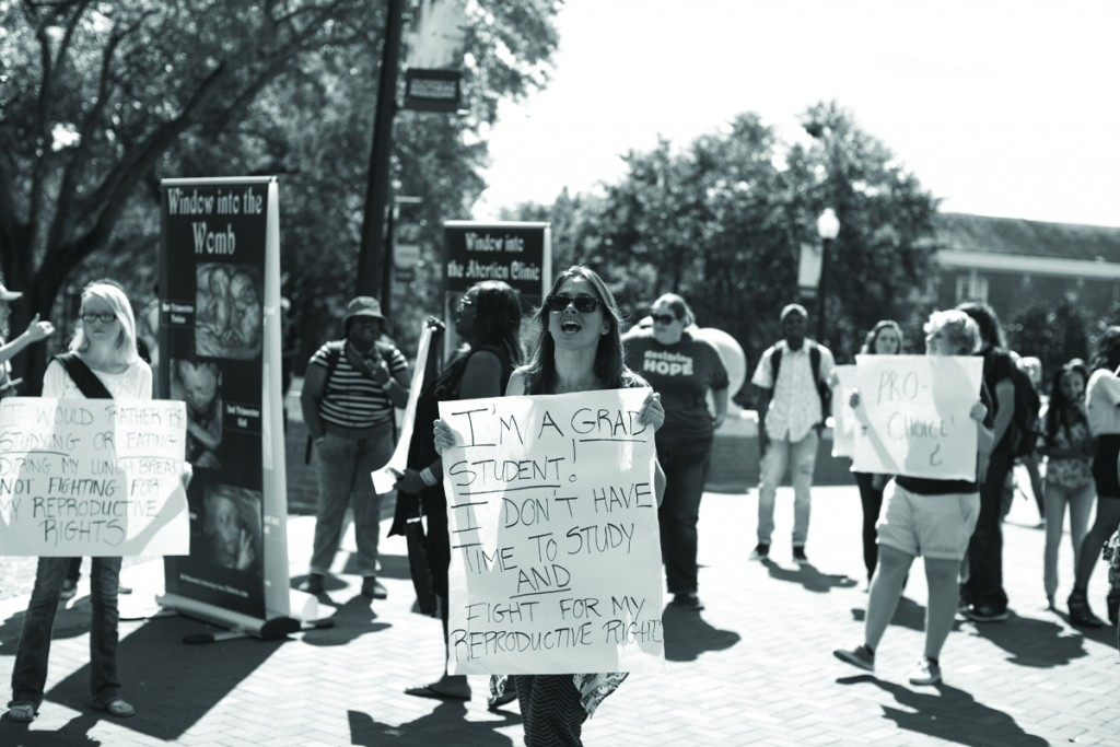 Brady Leatherwood protest with the women's rights advocates in Shoemaker Square Wednesday afternoon.  Students gather around in between classe to watch the anti-abortion activists that frequent the Southern Miss campus. -Kate Dearman Courtesy Photo
