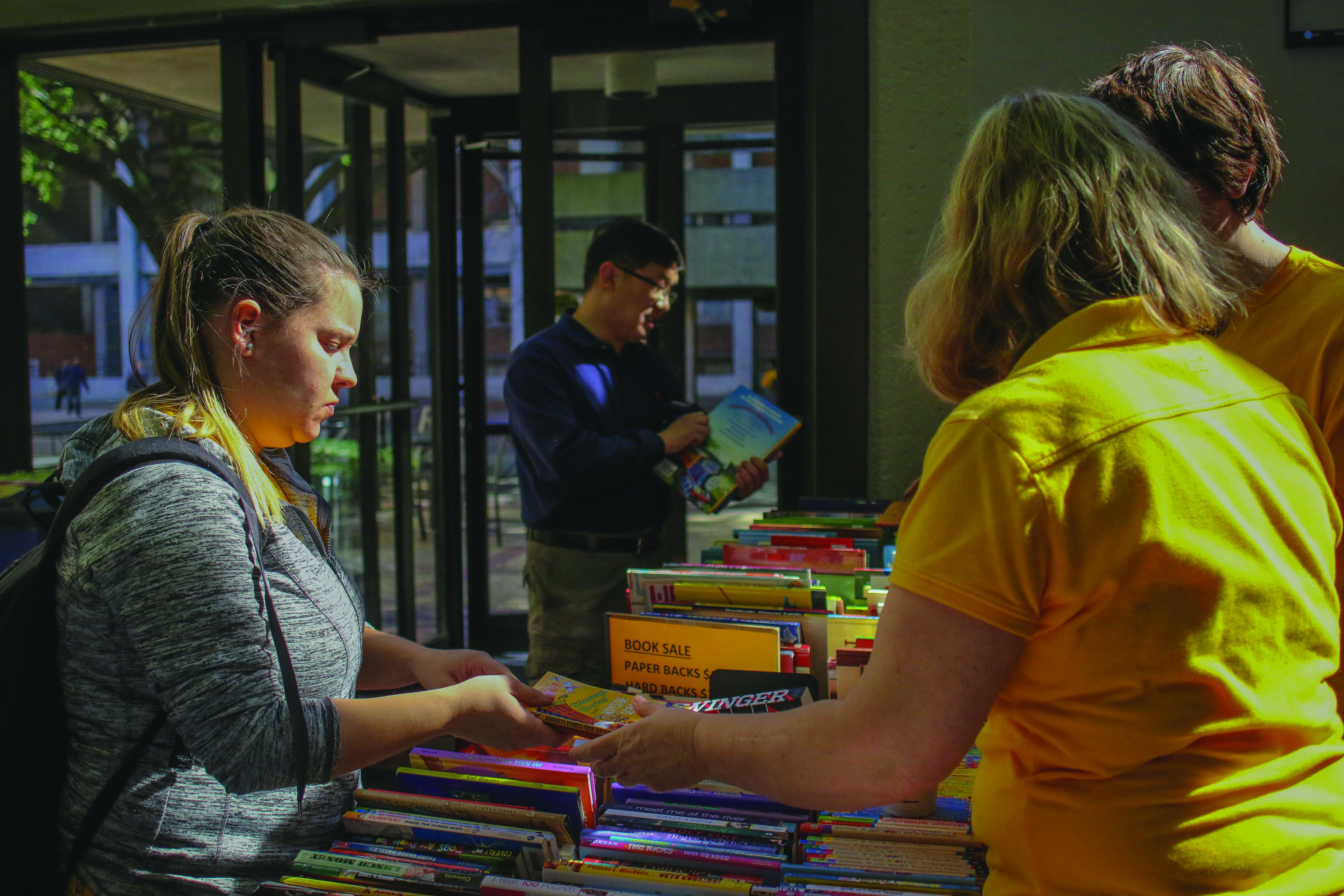 USM groups combat illiteracy with book sale