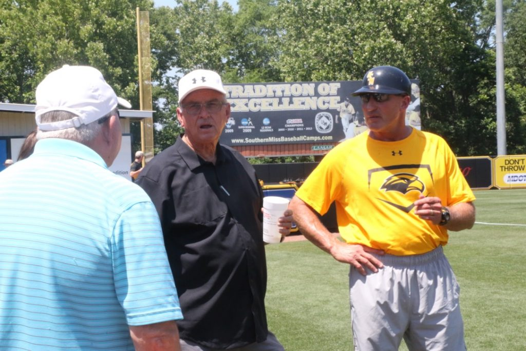 Corky Palmer, left, Hill Denson, center, and Scott Berry, right, all take in Southern Miss' practice before the C-USA tournament.