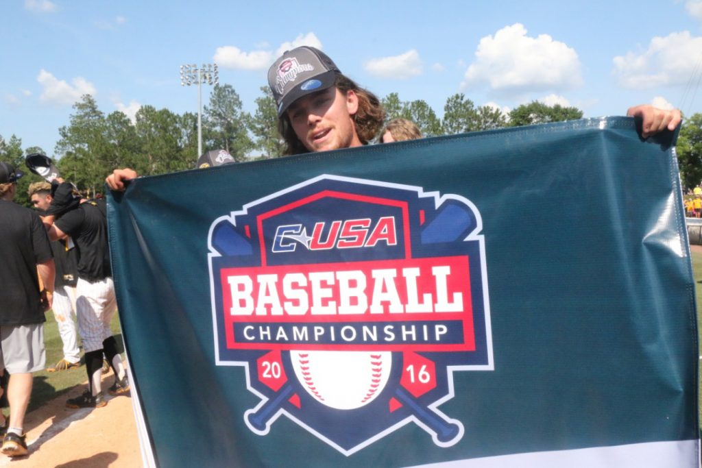Jake Winston poses with the C-USA championship banner after Southern Miss' 3-2 victory over Rice on May 29.