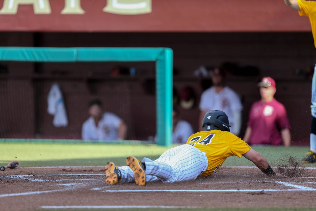 Dylan Burdeaux slides into home base against Florida State University at the Tallahassee Regional on June 4, 2016.