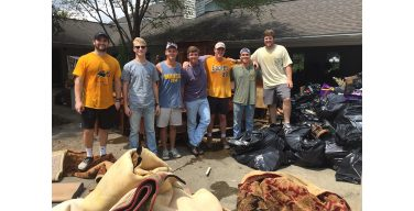 Frats lend hand to flooded homes