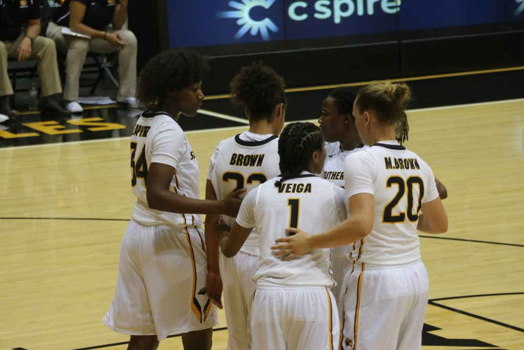 The Lady Eagles huddle before a free throw at Reed Green Coliseum on Nov. 8 against Mississippi College.