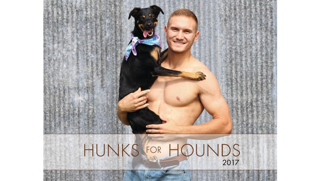 Hunks pose with pups for humane society