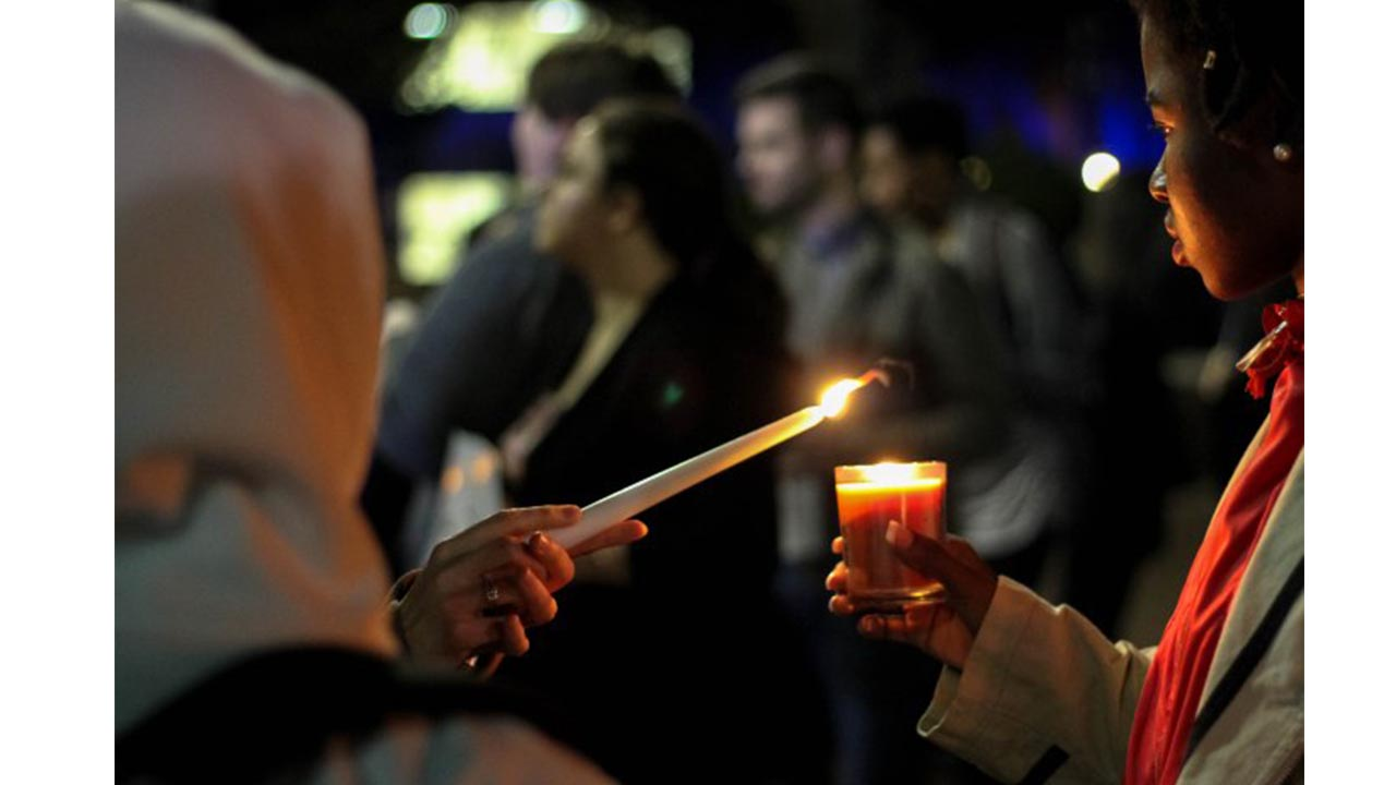 Community gathers for refugees, immigrant vigil