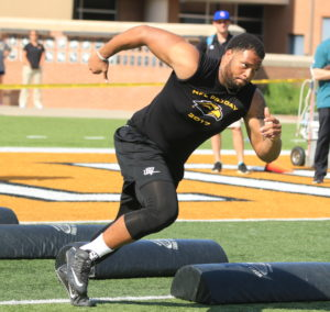 Former USM lineman Oliver Bates runs a speed drill on April 4 at Southern Miss' Pro Day.