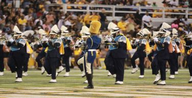 Competing universities' bands collaborate at football game