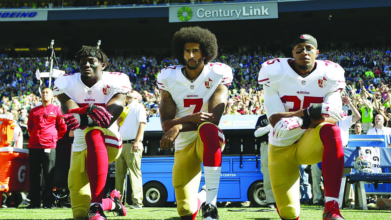 Athletes kneel to stand up for national anthem