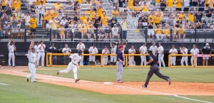 Tracy Hadley runs to first base for the  Golden Eagles