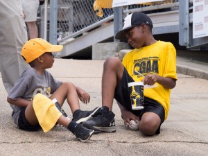Two children play during some down time  at the USM vs UIC game
