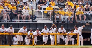 USM Golden Eagles Baseball team stading  in the dugout watching the game